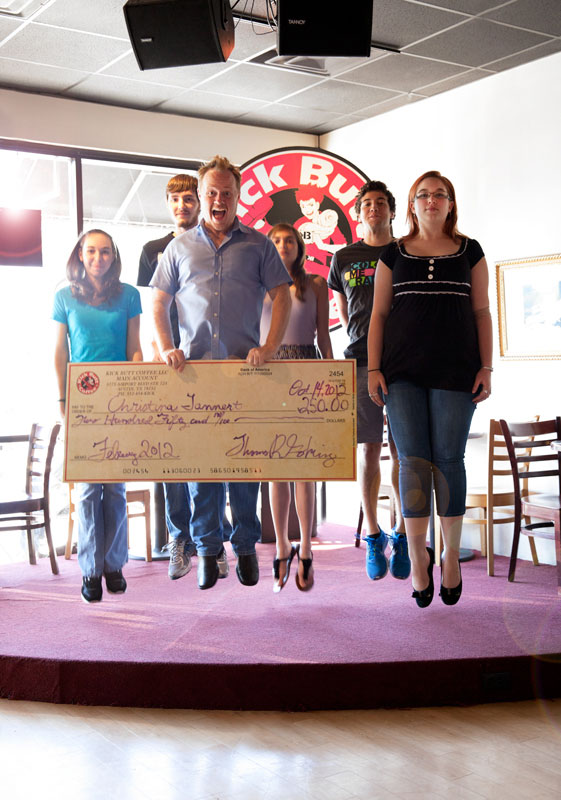Winners jump with giant check